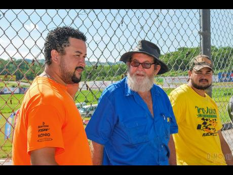 Peter talks with sons Peter Jr and Ishmael before a race at Dover.