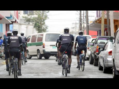 In this file photo, police patrol Barry Street on bicycles in downtown Kingston. There is an urgency to increase the number of boots on the ground, i.e., increasing the number of officers available for territorial policing duties in the short/medium term.