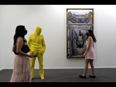 People visit Perrotin gallery of the 14th edition of Art Dubai at Dubai International Financial Centre, DIFC.