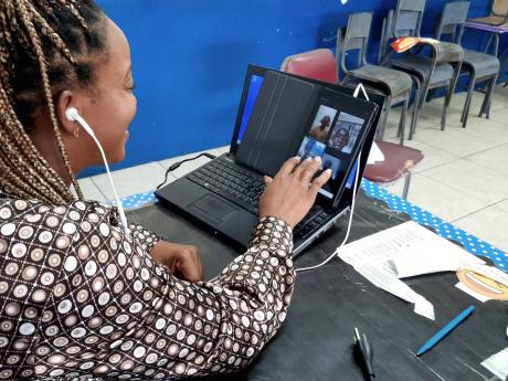 Camecia Vassell, grade six teacher at St Michael's Primary, interacting with some of her students during an online class last October.