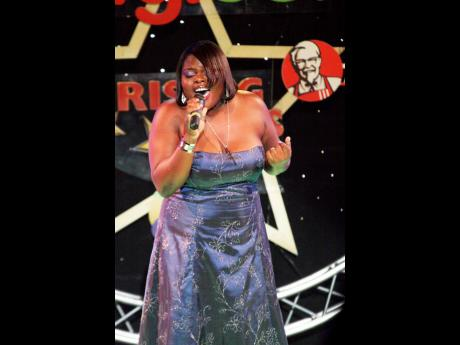 Tiffany Thompson performs during the 2008 Digicel Rising Stars competition. The accompanying vocalist and recording artiste reportedly died on Monday at the Port Antonio Hospital following a brief illness. She was 30 years old.