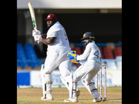 West Indies all-rouder Rahkeem Cornwall plays a shot down the leg side during his unbeaten knock of 60 runs on day-two of the first Test against Sri Lanka in North Sound, Antigua on Monday, March 22.