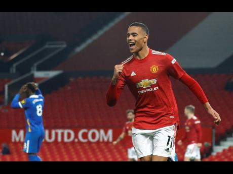 Manchester United's Mason Greenwood celebrates after scoring his side's second goal during their English Premier League match against Brighton and Hove Albion at Old Trafford, Manchester, England on Sunday.