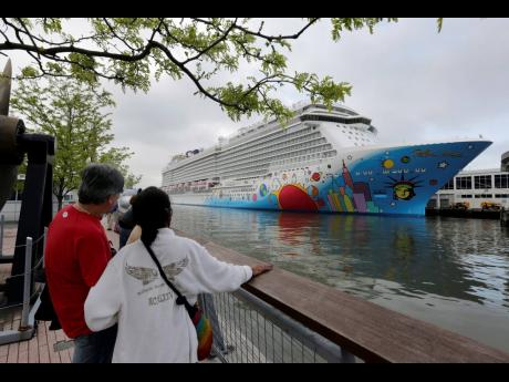 People pause to look at Norwegian Cruise Line's ship, 'Norwegian Breakaway', on the Hudson River in New York, in this May 8, 2013 file photo.