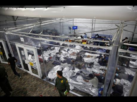 In this March 30, 2021 photo, minors inside a pod at the Donna Department of Homeland Security holding facility, the main detention centre for unaccompanied children in the Rio Grande Valley run by United States Customs and Border Protection, in Donna, Tex