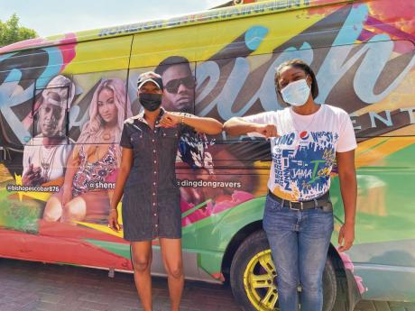 Yanique Dawkins (right), marketing coordinator of Pepsi-Cola Jamaica, elbow bumps Jade (left), public relations manager of Romeich Entertainment, at the Romeich headquarters following a donation of  beverages. Business mogul Romeich Major of Romeich Entert