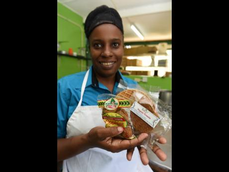 Johnson, the owner of Something Country, shows off her breadfruit cookies and vegan treats.