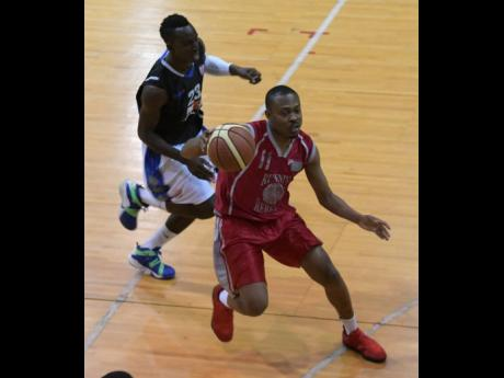 Urban Knights' Tommy McDonald (left) chases after UWI Running Rebels' Javaughn Bailey during a National Basketball League game at the National Arena on Saturday, February 10, 2018.