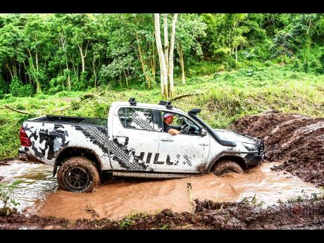Testing the might of the Toyota Hilux in the mud pit.
