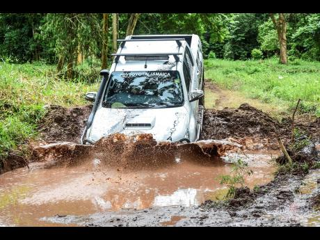 The Hilux proving that it can 'cross it'.