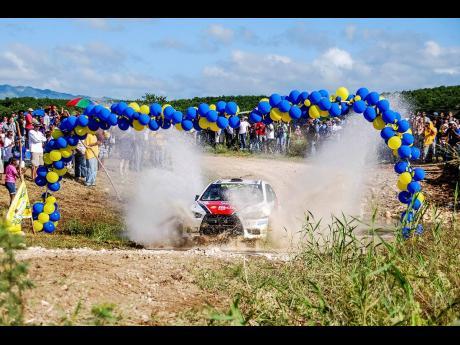 Jeffery Panton exits the water splash of Rally Jamaica 2011 in an EvoX.