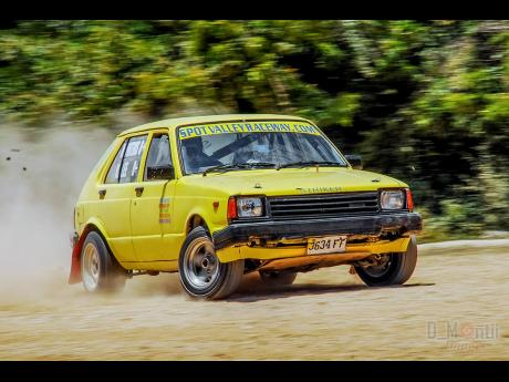 Marvin Porteous takes the Toyota Starlet through the loose-gravel course, at a sprint event at Spot Valley,  St James.