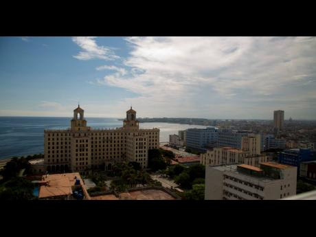 In this June 17, 2020 photo, the Hotel Nacional stands devoid of tourists amid the coronavirus pandemic in Havana, Cuba.