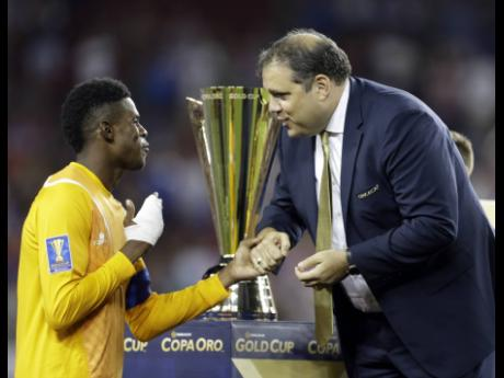 Concacaf President Victor Montagliani (right) talks with Jamaica goalkeeper Andre Blake after the United States beat Jamaica 2-1 in the Gold Cup final soccer match in Santa Clara, California, on Wednesday, July 26, 2017.