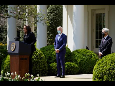 Vice-President Kamala Harris, accompanied by President Joe Biden and Attorney General Merrick Garland, speaks about gun violence prevention in the Rose Garden at the White House on Thursday, April 8, in Washington.