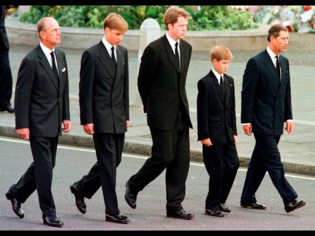 From left: Britain's Prince Philip, Prince William, Earl Spencer, Prince Harry and Prince Charles walk outside Westminster Abbey during the funeral procession for Diana, Princess of Wales on September 6, 1997.