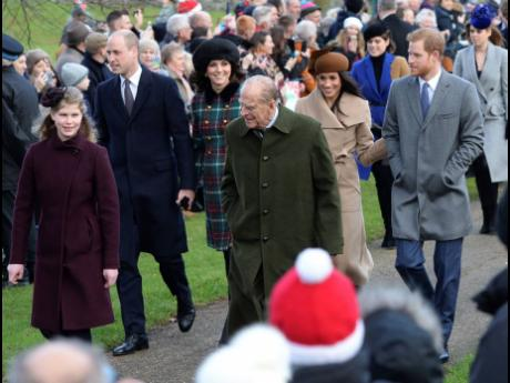 Britain's Prince Philip (centre), walks with Lady Louise Windsor (left), Prince William and Kate, Duchess of Cambridge, Prince Harry (right), and Meghan Markle, as they arrive to attend the Christmas Day morning church service at St Mary Magdalene Church i