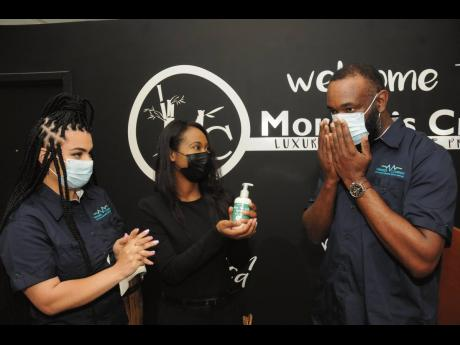 Virtudes co-founder and Chief Operating Officer Farrah Zargaran (left) and Morgan's Creek CEO Joni-Dale Morgan observe the reaction of Virtudes Chairman and CEO Jamiel Jamieson as he tests the hemp-based lotion manufactured by Morgan's Creek, on Thursd