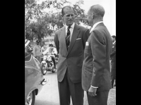 The Duke of Edinburgh, Prince Philip (left), speaking with P.J. (Bobby) Burns at the George VI Memorial Park (now National Heroes Park) on Sunday, April 27, 1975. Both men were shipmates for a brief period during World War II.