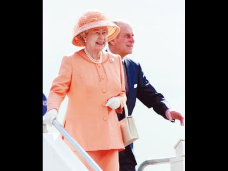 Britain's Queen Elizabeth II and her husband, Prince Philip, the Duke of Edinburgh, arrive at Jamaica's Norman Manley International Airport on February 18, 2002.