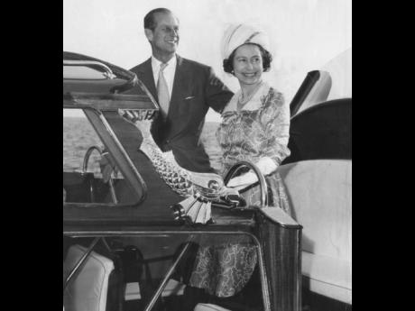 Her Majesty and Prince Philip, having completed the first leg of their five-day state visit to Jamaica, embark on the Royal barge at the Victoria Pier to be taken aboard the 'Britannia' anchored in the Kingston Harbour on April 28, 1975. The 'Britann