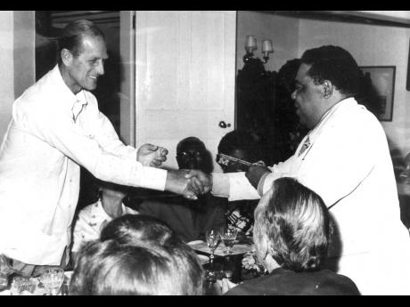 His Royal Highness Prince Philip (left) being presented with the key to Mandeville by Mayor C.C. Charlton in May 1975.