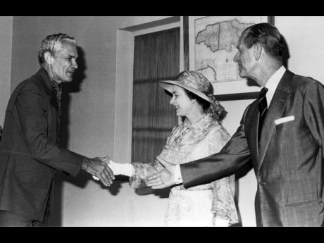Queen Elizabeth II and Prince Philip greeting Michael Manley in February 1983.