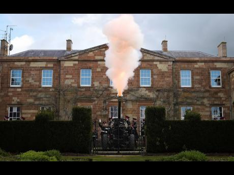 Members of the 206 Battery, 105th Regiment Royal Artillery fire a 41-round gun salute at Hillsborough Castle in Northern Ireland, Saturday, April 10, 2021. Britain's Prince Philip died on Friday.
