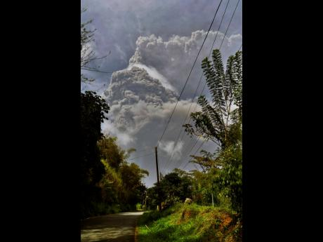 Plumes of ash rise from the La Soufriere volcano as it erupts on the eastern Caribbean island of St. Vincent, as seen from Chateaubelair on Friday, April 9.