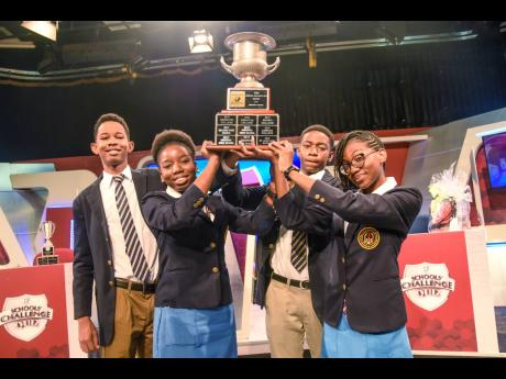 From left: Kaif Bailey, Chaunté Blackwood, Dauntae Wright, and captain Kelsi Grant hold the TVJ Schools' Challenge Quiz trophy. They defeated Wolmer's High School for Boys in a match that went to the wires and had to be decided by a review by the judg