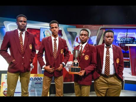 The team from Wolmer's High School for Boys, from left: Jerome Brooks, Raheem Spencer, captain Zaire Pinto, and Chevaughn Falkner with the runners-up trophy of TVJ Schools' Challenge Quiz.