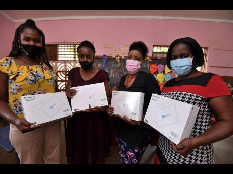 Teachers of Kitson Town Basic School in St Catherine, from left, Charline Nathan, Precious Thomas,  Joy Sterling, Principal, and Debbie-Ann Mcbean-Burt with their new tablet computers