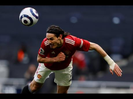 Edinson Cavani's diving header gives Manchester United the lead during their English Premier League match against Tottenham Hotspur at the Tottenham Hotspur Stadium in London, England, yesterday.