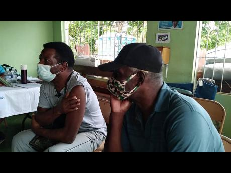 Visually impaired brothers Victor Ottey (left), 59, and Derek Ottey, 68, are fearful that countries will make it mandatory for travellers to be vaccinated for entry to their ports. The brothers got their COVID-19 shots at Downs Health Centre on Sunday.