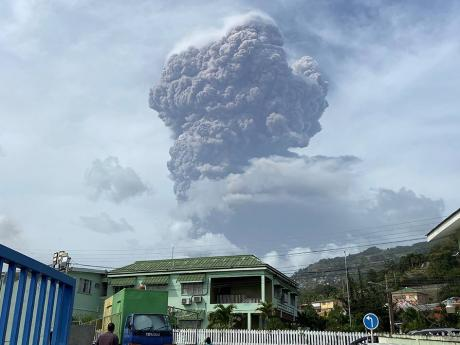 A plume of ash rises in the air and is seen from Kingstown, the capital of St Vincent and the Grenadines, on Friday.
