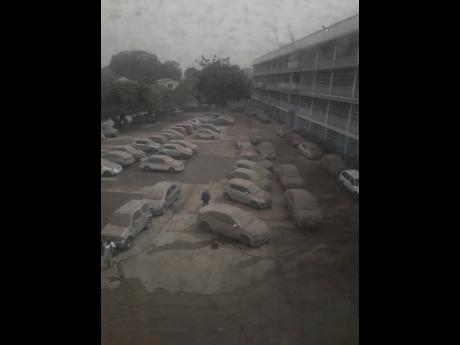 The car park at the Queen Elizabeth Hospital in Bridgetown, Barbados, is covered in ash and dust blown from the Soufriere Volcano.