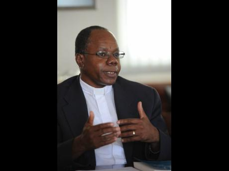 Canon Garth Minott was snubbed as the new Suffragan Bishop of Kingston.