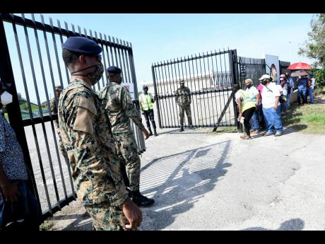 Soldiers man the gates of the National Arena, site of a vaccination blitz on Monday.