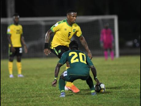 Jamaica's Alvas Powell attempts to go past Guyana's Trayon Bobb during a Concacaf Nations League match at the Montego Bay Sports Complex on Monday, November 18, 2019.