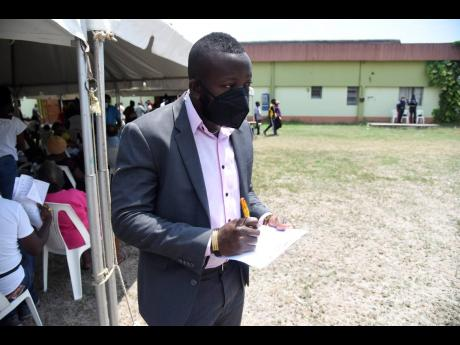 Jason Brown, 27, a sales executive, turned out to get vaccinated at Twickenham Park Open Bible Church on the fringes of Spanish Town on Monday.