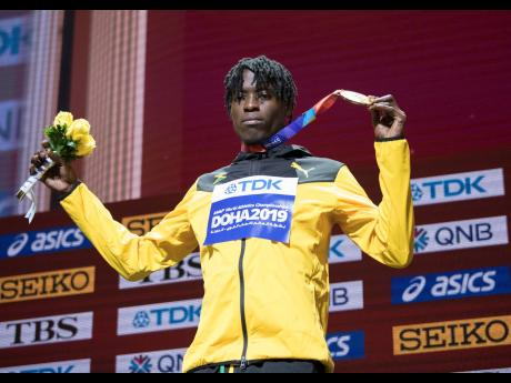Tajay Gayle poses on the medal podium after taking gold in the long jump at the  2019 IAAF World Athletic Championships, held at the Khalifa International Stadium in Doha, Qatar, on Sunday September 29, 2019.