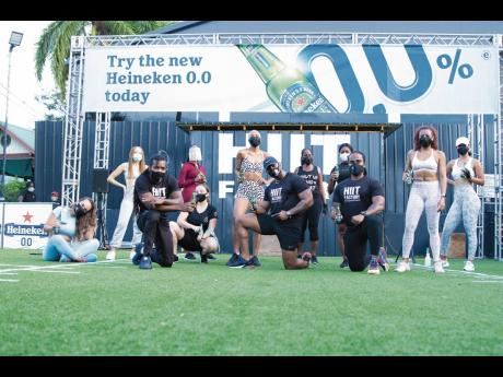 Heineken HIIT Experience participants (back, from left): Veronika Sramata, Emma Watson, Shanikay Lawson, Anezka Libovicka, Dianne Brown, Shelly Dunkley, Riana Battick and Tiffany Guthrie. (Front, from left): Jawara Fairweather, Andre Brown, Geovanie Morgan
