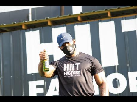 Heineken 0.0 in hand, fitness trainer Andre Brown takes a break from the high-intensity interval training.