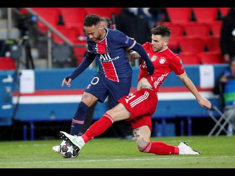 PSG's Neymar (left) and Bayern's Lucas Hernandez challenge for the ball during the Champions League, second leg, quarterfinal match between Paris Saint Germain and Bayern Munich at the Parc des Princes stadium, in Paris, France, yesterday, April 13, 20