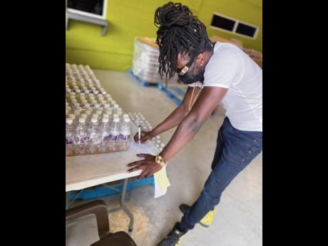 Skinny Fabulous checks off the water stock at one of the collection sites in St Vincent. Water is one of the greatest needs in St Vincent and the Grenadines as the natural resource has been contaminated with volcanic ash.
