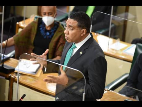 Prime Minister Andrew Holness addresses Parliament on Thursday, March 18. Holness railed against unnamed persons for peddling misinformation.