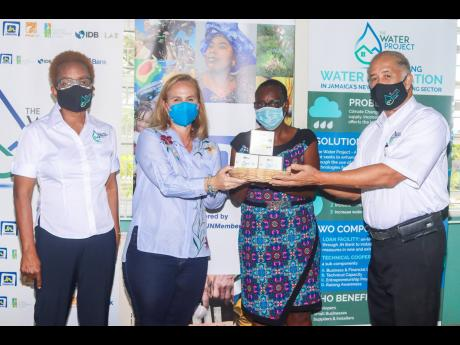 Parris Lyew-Ayee (right), chairman of the JN Foundation, presents water-efficiency kits to Tanya Wildish (second left), director, Wortley Home For Girls. Sharing in the moment are Mary Allen-Smith (left), director of the JN Foundation, and Delores Bailey,