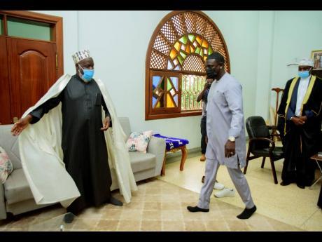 Akon (right) is welcomed by the Mufti of Uganda, Shiekh Shaban Mubajje, at the Gaddafi National mosque, in Kampala, Uganda.