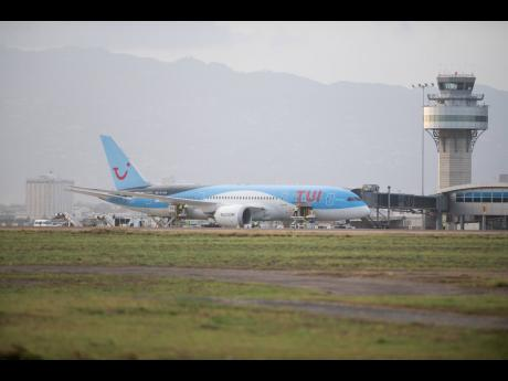 More than 100 Jamaicans, including 75 shipworkers, arrive at the Norman Manley International Airport on a TUI flight from the United Kingdom on May 6, 2020, under the watchful eye of air traffic control tower operators. The Jamaica Civil Aviation Authority