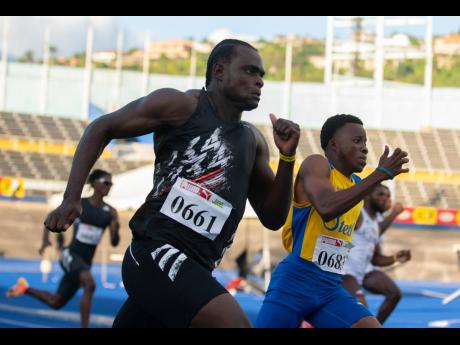 Jevaughn Minzie (left) of Titans Track Club competes in the 200m event at the Jamaica Athletics Administrative Association Qualification Trials 3.6 held at The National Stadium on March 13, 2021.